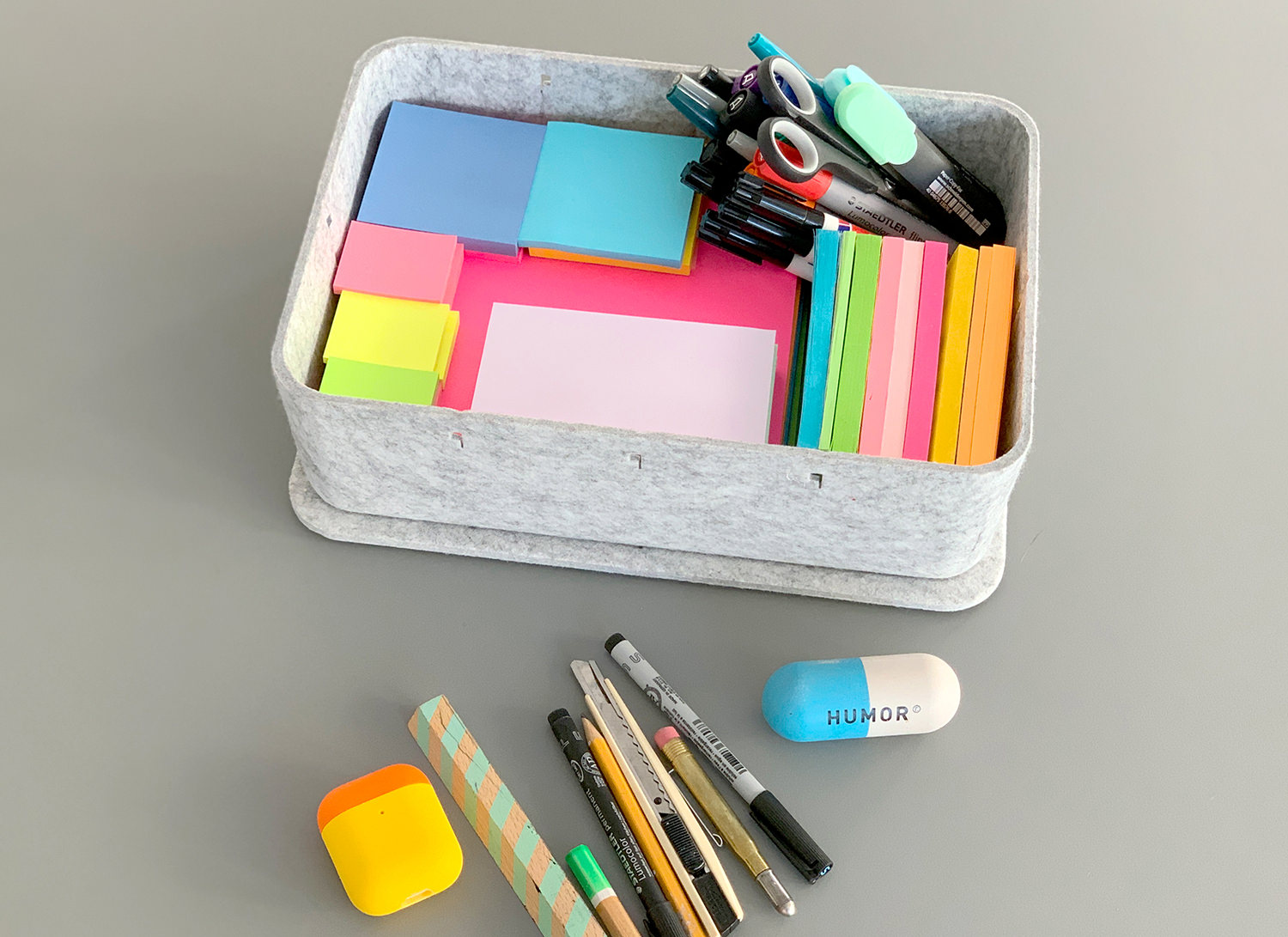 we see a workshop toolbox with pencils and post its